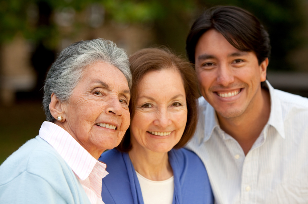 Family portrait of a grandmother, her daughter and grandson smiling